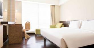 诺富特曼纳多高尔夫会议度假酒店 - 万鸦老 - 睡房