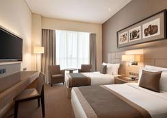 阿布扎比市中心爵怡温德姆酒店 - 阿布扎比 - 睡房