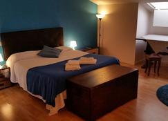 吉徕旅馆 - 科摩 - 睡房