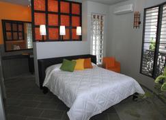 埃尔玛格尼菲科公寓式酒店 - 苏莎亚 - 睡房