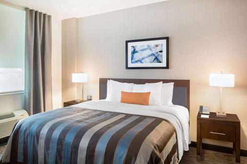 迈阿密机场温德姆集团温盖特酒店 - 多拉 - 睡房