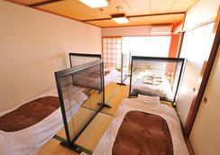 阳之笑温泉青年旅馆 - 热海市 - 睡房