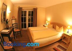 奥佩霍夫加尼酒店 - Garmisch-Partenkirchen - 睡房