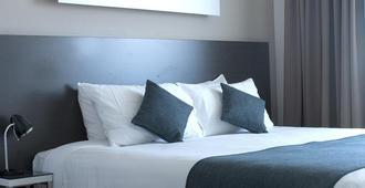 图格拉侬阿伯德酒店 - 堪培拉 - 睡房
