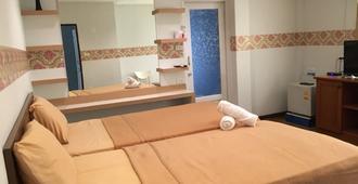 瓦拉迪水疗别墅度假村 - 曼谷 - 睡房