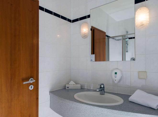 莱比锡博览中心温德姆戴斯酒店 - 莱比锡 - 浴室
