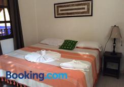 波萨达阿吉拉实酒店 - 帕伦克 - 睡房