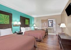 加尔维斯顿速8酒店 - 加爾維斯敦 - 睡房
