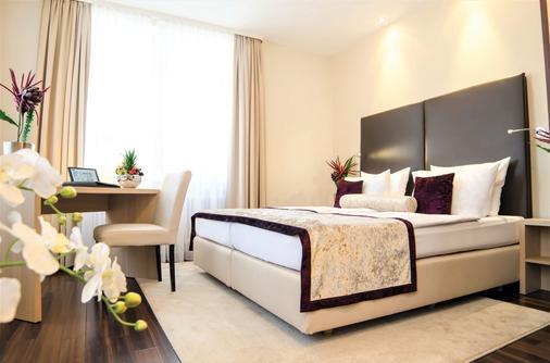 默克高级酒店 - 巴登-巴登 - 睡房