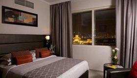 多哈皇家海滨酒店 - 多哈 - 睡房