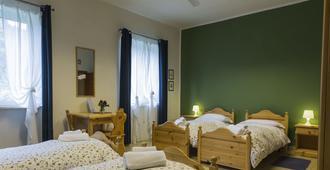 里奥沃尔诺酒店 - 卢卡 - 睡房