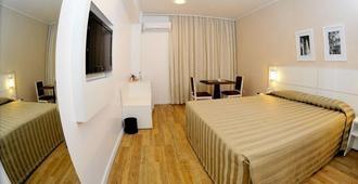 圣拉斐尔广场酒店 - 阿雷格里港 - 睡房