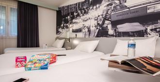 宜必思尚品巴黎托尔比亚克图书馆酒店 - 巴黎 - 睡房