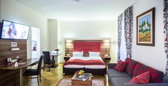 巴图生活酒店 - 慕尼黑 - 睡房