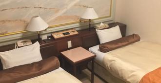 阳光酒店 - 东京 - 睡房