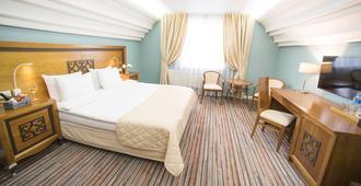 莫斯科布鲁斯酒店 - 莫斯科 - 睡房