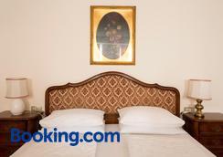 卡斯特尔瑞登酒店 - 梅拉诺 - 睡房
