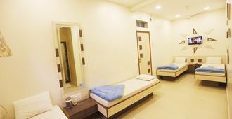 阿尔莫阿辛酒店 - 孟买 - 睡房