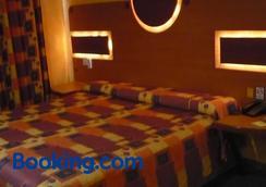 环球酒店 - 墨西哥城 - 睡房