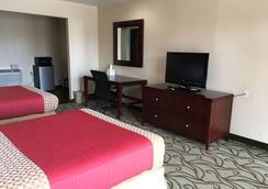 德克萨卡纳美洲最佳价值酒店 - Texarkana - 睡房