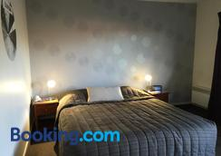 科莫多尔汽车旅馆 - 但尼丁 - 睡房