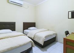 沙马林达旅馆 - 三马林达 - 睡房