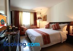 卡尔努瓦套房酒店 - 巴科洛德 - 睡房