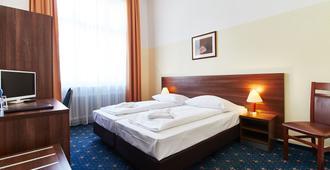 柏林欧罗巴城市酒店 - 柏林 - 睡房
