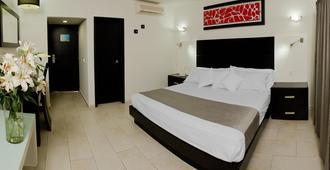 波多诺伏广场博览酒店 - 瓜达拉哈拉 - 睡房
