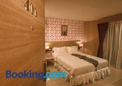 雷特罗39号酒店 - 曼谷 - 睡房