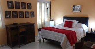 波哥大中心卡萨金塔酒店 - 波哥大 - 睡房
