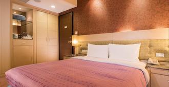 台北万泰商务旅店 - 台北 - 睡房