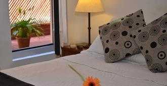 河流旅馆 - 科洛尼亞德爾薩克拉門托 - 睡房