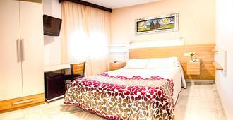 阿尔贝罗酒店 - 格拉纳达 - 睡房