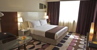 阿布扎比金丝盖特酒店 - 阿布扎比 - 睡房