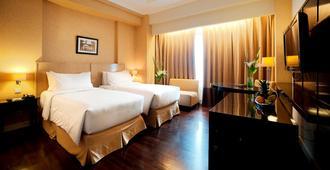 皇家黄铜酒店 - 南雅加达 - 睡房