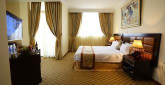 卡拉萬飯店 - 亚的斯亚贝巴 - 睡房