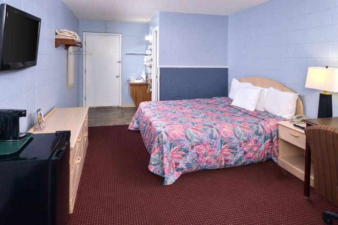 布兰森美洲佳价套房酒店-近大道 - 布兰森 - 睡房