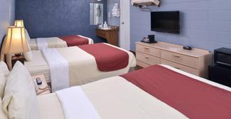 布兰森美洲最佳价值套房酒店 - 近赌城大道 - 布兰森 - 睡房