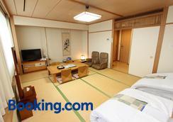 熊本米尔帕曲酒店 - 熊本 - 睡房