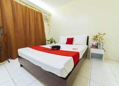 瑞德多兹酒店 @ 拉巴斯伊洛伊洛雷德斯科大道 - 伊洛伊洛 - 睡房
