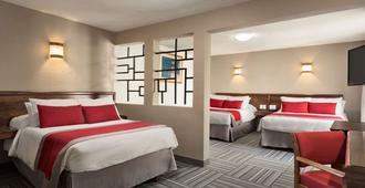 莱昂广场华美达酒店 - 利昂 - 睡房