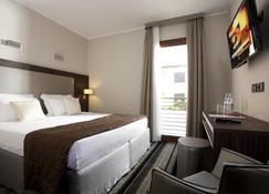 西方最佳威尼斯机场缇香酒店 - 泰塞拉 - 睡房