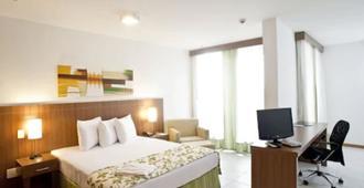 诺比尔纪念套房酒店 - 巴西利亚 - 睡房