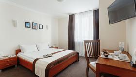 奥德斯克德日克酒店 - 敖德萨 - 睡房