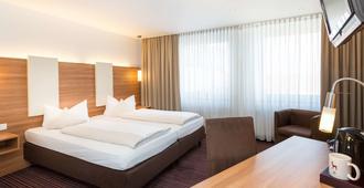 路德维斯沃克里斯特尔酒店 - 慕尼黑 - 睡房