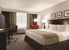 乡村旅馆及特拉弗斯城套房酒店 - 特拉弗斯城 - 睡房
