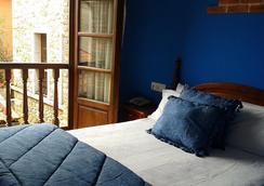 厄尔埃斯皮诺乡村酒店 - 坎加斯德奥尼斯 - 睡房