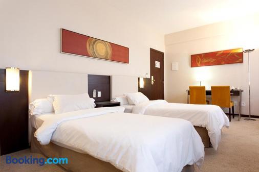 萨瓦西皇家精品酒店 - 贝洛奥里藏特 - 睡房