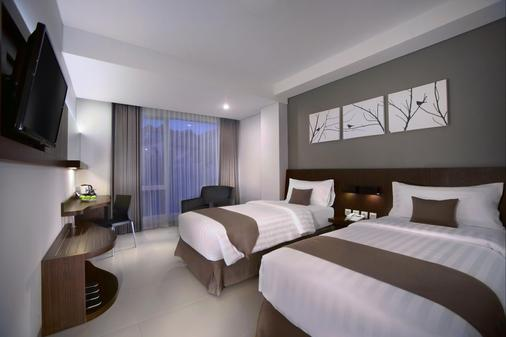 登巴萨neo酒店 - 登巴萨 - 睡房